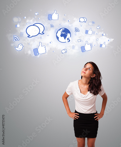 pretty woman looking social network icons in abstract cloud