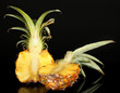 Sliced ripe pineapple isolated on black