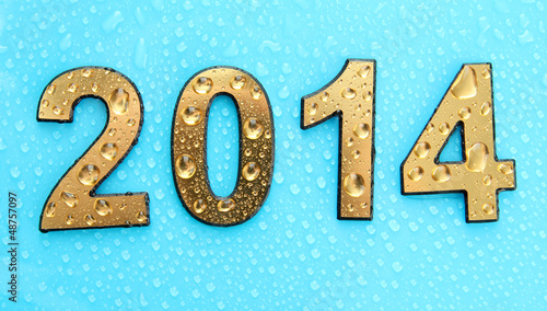 2014 in golden numbers, on blue background