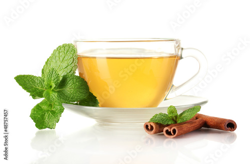 Cup of tea with mint and cinnamon isolated on white