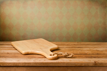 Background with cutting board on wooden table