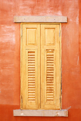 closed wooden windows in Italian style