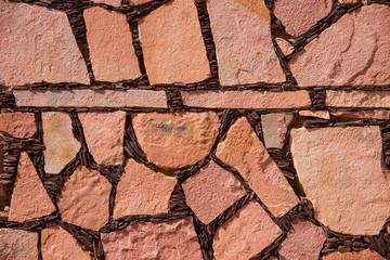 Textura de muro de piedras, con juntas oscuras.