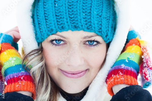 Closeup Portrait of Attractive young woman in wintertime outdoor