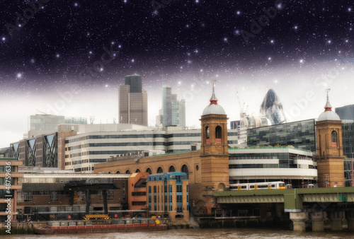 Stars over City of London, financial center and Canary Wharf at