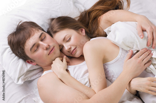 young husband and  wife sleepping