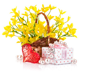 gift with red heart and yellow flowers in basket isolated on