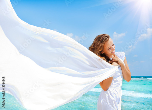 Beautiful Girl With White Scarf on The Beach