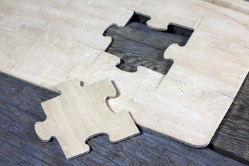Puzzle on wooden boards team business concept