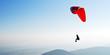 Paragleiter schwebt am Himmel - 48765024