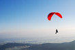 canvas print picture - Roter Paragleiter am Himmel