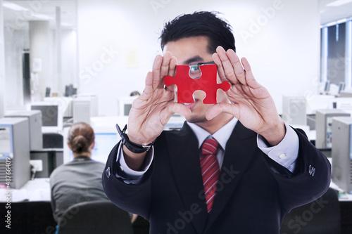Businessman shows missing piece