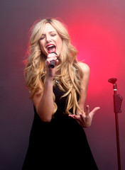 Beautiful Blonde Rock Star on Stage Singing