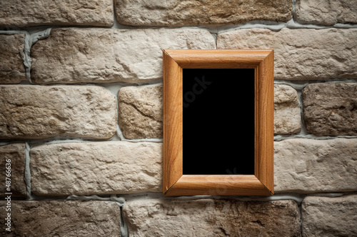 photo frame on brick wall