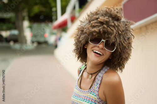 A beautiful young woman in a wig of curly hair