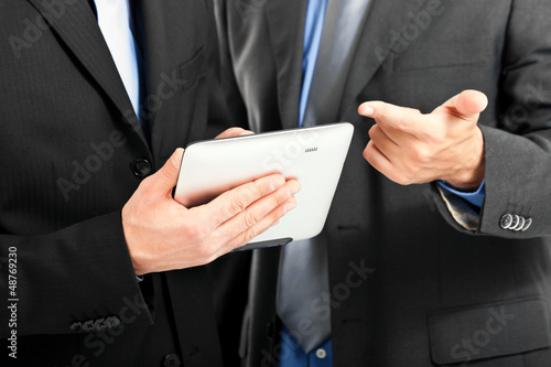 Businessmen watching a tablet