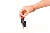 Male hand holding a car key