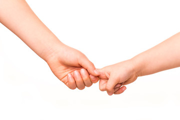 Two kids holding hands together.