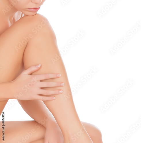 Woman touching her leg