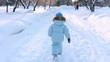 Child running through alley in Winter park (SLOW)