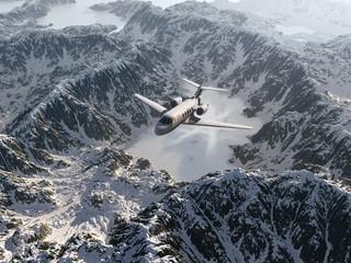 aircraft flies over a snowy mountain range
