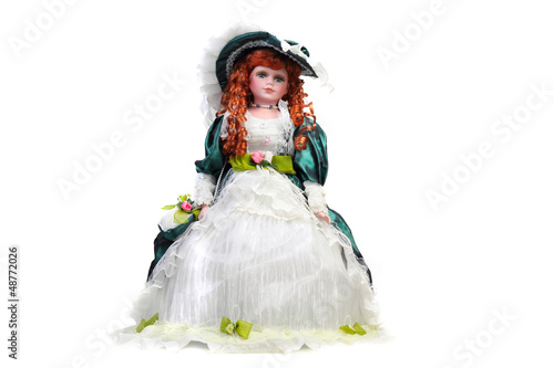 Isolated red-haired doll