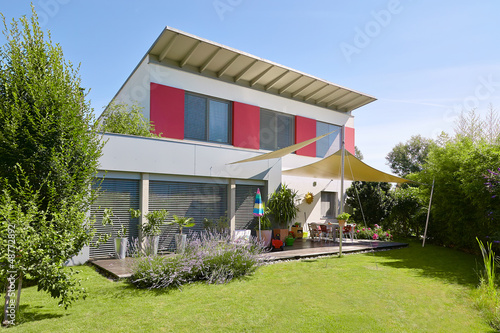 canvas print picture House with beautiful garden