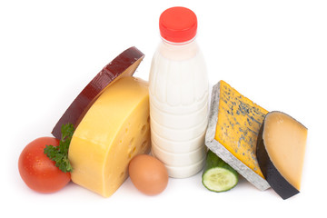 Various types of cheese and milk isolated on white