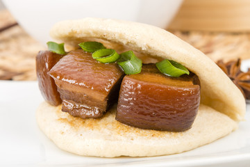 Hong Shao Rou - Chinese braised pork belly in a  steamed bun