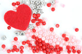 heart with stars and beads on white background