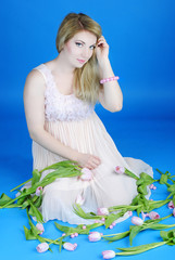 Beautiful pregnant girl with rose tulip