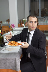 Man in a Restaurant Complaining of Pasta
