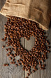 Heart shape made from coffee beans on wooden table