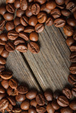 Close-up of heart shape made from coffee beans on wooden surface