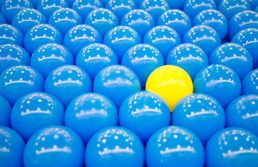 Unique yellow ball among blue balls