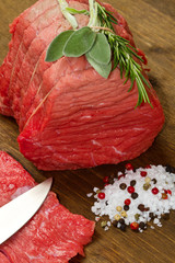 Raw beef on wooden table
