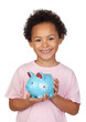 Happy latin child with a blue moneybox