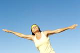 Mature woman balance exercising outdoor