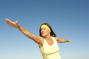 Healthy mature woman exercising outdoor isolated