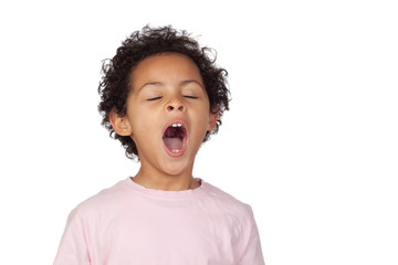 Happy latin child yawning