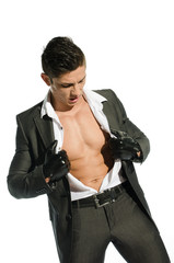Portrait of young muscular man unbuttoned his shirt