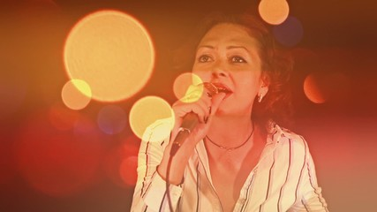 Woman singing in microphone with awesome bokeh