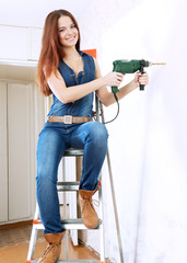 woman makes repairs in home