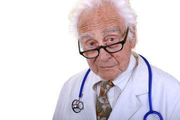 senior doctor in glasses looking into camera