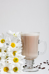 Cup of Cappuccino with Сinnamon and White Flowers