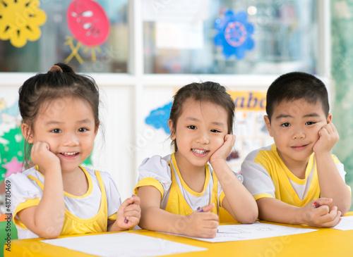 Boy and girls sitting in the kindergarten