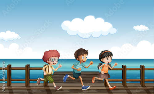 Kids running on a wooden bench