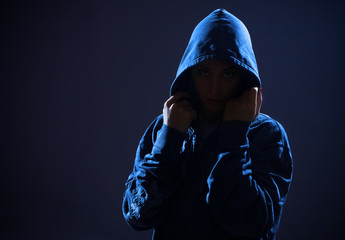woman with hood in darkness