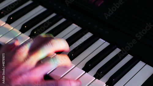 a man playing a  synthesizer