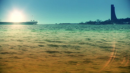 Cargo ship sailing at sunset, time lapse